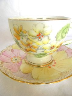 vintage dainty floral tea cup and saucer by snugsnuggery on Etsy