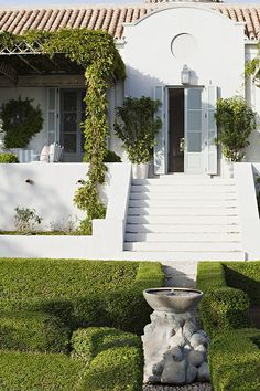gorgeous landscaping. Love the idea of doing all green.