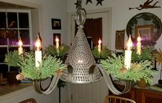 Candle Rings on Tin Chandelier: Sometimes it's the little things that make you take notice. These arborvitae  candle rings  are a very inexpensive ($3.95 each) addition to ...