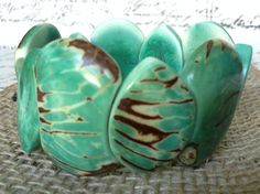 MINT GREEN CHUNKY BRACELET MADE WITH TAGUA NUT  This Eco Friendly Bracelet is so unique!, definitely one of a kind. Its so colorful and fun to wear, its the perfect accessory for any ocassion, you can dress it up or down, either way itll be stunning.  This bracelet is made of Tagua nut. Tagua has been hand picked, carved, dyed and polish to make the most beautiful bohemian jewelry. This bracelet has Tagua skin left on, to give this bracelet a rustic look.  This cuff bracelet is made of 9…
