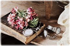 books, flowers and watches form a lovely vignette for a table.