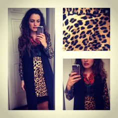 Leopard print skirt, geometric flower shirt and black long vest accessorised with orange zipper necklace and black boots. Streetstyle.