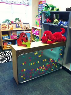 Attach a large metal drip pan to the back of a bookshelf to make a word-work center. Attach a large metal drip pan to the back of a bookshelf to make a word-work center. New Classroom, Classroom Setting, Classroom Design, Classroom Ideas, Preschool Classroom Layout, Preschool Library Center, Preschool Reading Corner, Toddler Classroom Decorations, Daycare Decorations