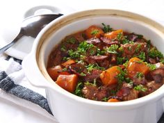 Tender Beef and Bacon Casserole slowly simmered in red wine and tomato base.
