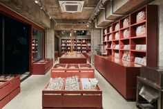 Schemata Architects has painted the interior of this dried food store in Tokyo the same shade of red as the skinny building it& set inside. Contemporary Architecture, Interior Architecture, Interior Design, Relax House, Tokyo, Food Retail, Retail Windows, Japanese Interior, Cafe Shop