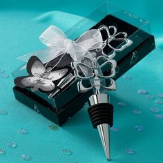 Butterfly Bottle Stopper Wedding Favor | #exclusivelyweddings Maybe not exactly this but a bottle stopper isn't a bad idea