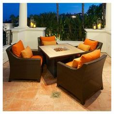 "Hand-woven outdoor patio set with Sunbrella cushion covers. Includes four arm chairs and a marble-topped fireplace table.   Product: Fire table and 4 chairsConstruction Material: Polyethylene wicker, aluminum and Sunbrella fabricColor: Brown and orangeFeatures:  UV, weather and fade resistantCushions and accent pillows included Dimensions: Table: 25.5"" H x 44"" W x 44"" DChairs: 31.5"" H x 29.5"" W x 33"" D each"