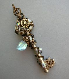 #Steampunk  wire wrapped key pendant with large crystal leaf bead