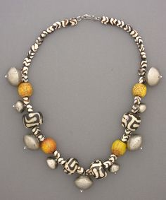anne holland jewelry | Nice composition. by Anne Holland | Small and large batik bone beads ...