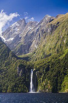 Beautiful waterfalls, Milford Sound, Fiordland National Park, New Zealand.