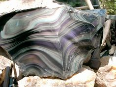 Rainbow Obsidian, Igneous , glass like, cooled  too quickly to form crystals when expelled from the Volcano.
