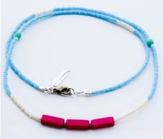 Blue Neon Necklaces by ViaMinima >>  These are so cute! Love the feather detail.