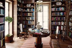 The foyer of a Monte Carlo house designed by Timothy Whealon also doubles as a library.