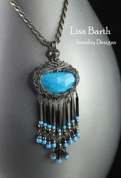 I think I am infatuated with fringe. I can't help myself, another fringy, dangly piece with turquoise. It is just too much fun. The back has something new, adding seed beads to the wire work in a pattern and a cross charm.