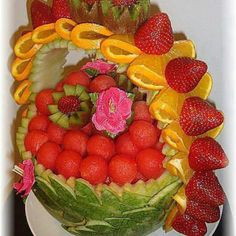 A WATERMELON and ORANGE BASKET OF STRAWBERRIES and KIWI FRUIT