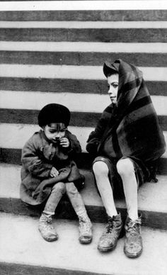Warsaw, Poland, Two children sitting on steps in a ghetto street, 1940-1943.