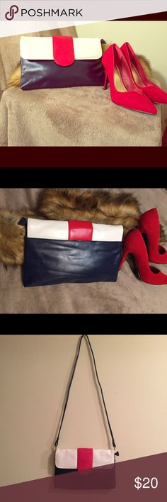 "Vintage red, white and blue purse ❤️ Beautiful vintage purse that can be worn as a clutch or with the optional strap. This is a good size clutch measuring at 12 1/2"" W. There is a compartment on the back and several inside the bag. Spotless inside. Great vintage condition with no peeling or bruising 😍😍 Bags"
