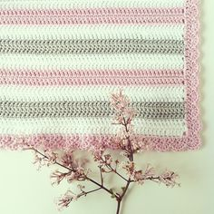 Baby blanket. Love the cherry blossom colours.  Links to a picture only