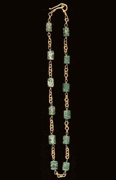 A ROMAN GOLD AND GLASS NECKLACE Circa Century A. Composed of lengths of loop-in-loop chain joined to links threaded through glass beads imitating natural emerald crystals, terminating in a hook-and-loop closure Renaissance Jewelry, Medieval Jewelry, Ancient Jewelry, Victorian Jewelry, Antique Jewelry, Byzantine Jewelry, Vintage Jewelry, Glass Necklace, Glass Jewelry