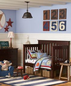 If your little slugger enjoys all kinds of sports chances are good he would feel right at home in a sports themed toddler room. The dark wood toddler bed and accessories are available through Pottery Barn Kids. What an adorable idea for toddler boys! sports nursery decorations