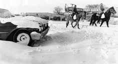After snow fell on Jan. 4, 1971, H.L. Vaughn and his son Rick saddled up their horses to get supplies from a market at 42nd Street and Redman Avenue. THE WORLD-HERALD