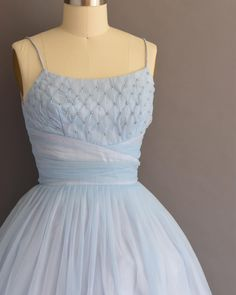 This 1950s pearl covered icy blue chiffon dress is coming to the shop today. Size small.