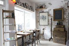 Oooh, I like that exposed brick wall. Home Office, Office Style, Stair Shelves, Ladder Bookshelf, Style Loft, Cafe Style, Restaurant New York, Art Restaurant, Rustic Restaurant
