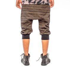 """Men's 3/4 drop crotch sweatpant short jogger with """"EarthTRiBE"""" striped tribal design all-over print and brass grommets. Designed by AndreasOne for PEACEfits."""
