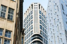 Eagle House is situated in the technology City of London. Moleanos was the limestone used for cladding of Eagle House building. House Building, London City, Cladding, Portuguese, Facade, Multi Story Building, Eagle, Around The Worlds, Exterior