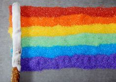 how to make rainbow pretzel sticks | Place a chocolate covered pretzel at the edge of the sprinkle ...