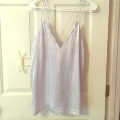 Free people light blue tank Scalloped top low neck. Goes with everything! Free People Tops Blouses