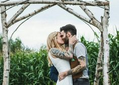 This cute outdoorsy couple really embraced the rustic themed wedding look. They're so in love, it's adorable.