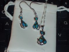 LOOK!!!! A  PAIR OF STERLING SILVER GENUINE AUSTRALIAN BLUE OPAL CAT EARRINGS AND MATCHING NECKLACE