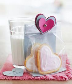 Add a special touch to a package of cookies with simple paper hearts, held together with a brad.