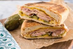 "No one can seem to agree on where and when the Cuban sandwich originated, but most can agree that it's delicious. This humble sandwich is workingman's fare for the cigar makers and sugar cane field workers in Cuba, and among the Cuban communities in Florida. Walk down Calle Ocho in Miami's Little Havana neighborhood, and you'd be hard-pressed to not find a café selling ""sandwich mixto"" along with little cups of intense Cuban coffees."
