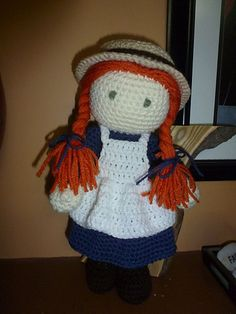 Anne (with an E) is all ready for school or church in her pretty blue dress, white pinafore and of course her straw hat!