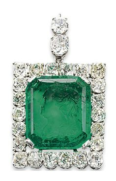 A CARVED EMERALD AND DIAMOND PENDANT.   Set with a rectangular-cut emerald intaglio, depicting Catherine The Great of Russia in profile, to the old-cut diamond frame and top, 4.5 cm, in black suede fitted case