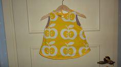Vändbar babyklänning