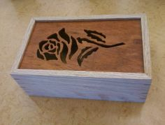 nothing fancy, simple rose scroll saw design, box cut out using a bandsaw and a jig