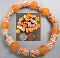 Oranje mix van Afrikaanse kralen. beschilderde glazen kralen en transparante glaskralen