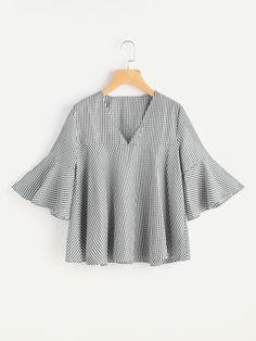 Blusa de cuadros con cuello en V