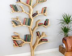 Display your books in full pride with the BespOak Elm Tree Wood Bookshelf. This bookshelf looks like a tree growing out of your floor.