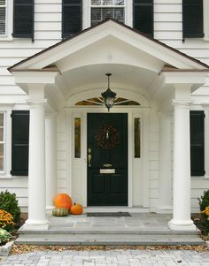 But front porch also play an important role, too. If you have small front porch, you will think that it can be hard to decorate it. Colonial Front Door, Colonial Exterior, Front Doors, Exterior Trim, Traditional Exterior, Front Entry, Front Door Overhang, Colonial House Exteriors, Garage Doors