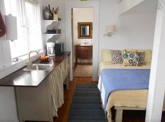 Inside you'll find a traditional studio layout with a single bed, living space, kitchen and bathroom. #TinyHouseforUs