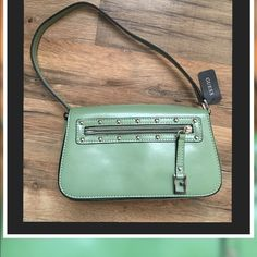 "Guess Mini Handbag... Perfect fit for IPhone 6S+ Guess Mini-bag color: Moss Size approx: 8 1/2""X 5""X 2 1/2""Front flap has a zipper pocket/also zipper pocket inside.. Magnetic closure on front Strap has approx 7 1/2"" drop New with tags...Style: VY106482 Group:Venom Babies Guess Bags Mini Bags"
