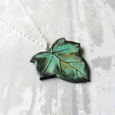 Ivy Leaf Necklace Green Patina Brass Charm on by SheBearDesigns, $24.00 very cute..a musthave