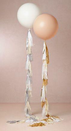 A great twist to balloon decor. Use a tassel as a string! #DIY #balloon