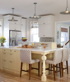 Sarah Richardson's farmhouse kitchen in Canada with Ikea cabinets and custom yellow island