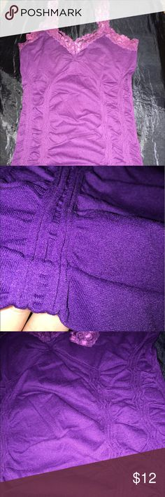 Purple Lace Stretchy Top This purple Lace detail top is stretchy and has been worn a few times but still has a lot of life in it! Comes from a smoke free home. Fits a size 10 Tops