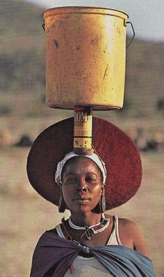 Zulu woman carrying water, South Africa National Geographic 1984